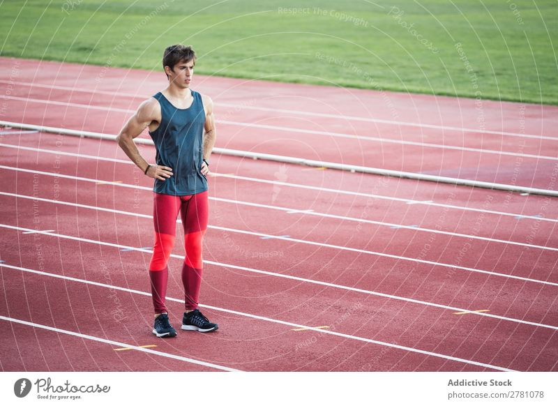 Sportsman standing on stadium Man Racecourse Posture Rest sportsman Fitness Practice Athlete Muscular Relaxation Adults Stadium Sprinter Break Sportswear