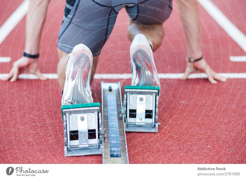 Man using starting block for running sportsman Racecourse crouch start Sprinter Starting block (swimming) Stadium Success Sports Fitness Practice Athlete