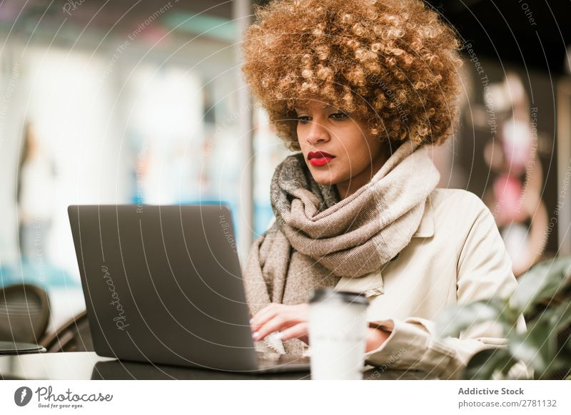 Stylish young woman using laptop in cafe Woman Style Adults pretty Hair and hairstyles Café Notebook browsing Coffee Blonde Beautiful Attractive Fashion Model