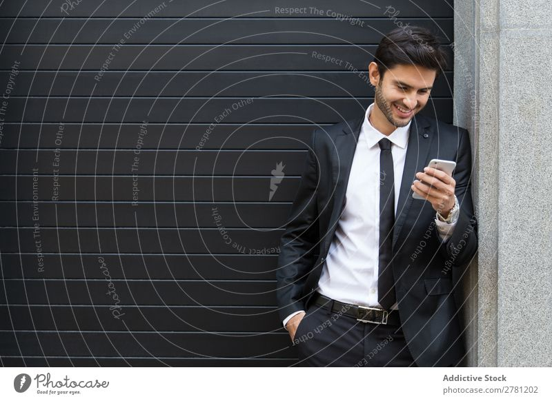 Elegant Young Businessman in the Street Using a Mobile Phone Man Fashion handsome Youth (Young adults) Looking Model Human being Background picture Suit Modern