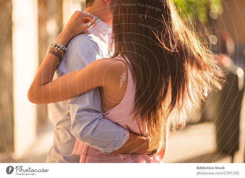 Romantic couple dancing in sunlight Couple Embrace Dance Movement Horizontal flying hair Close-up Crops Unrecognizable Romance Street Rear view Sunlight Bright