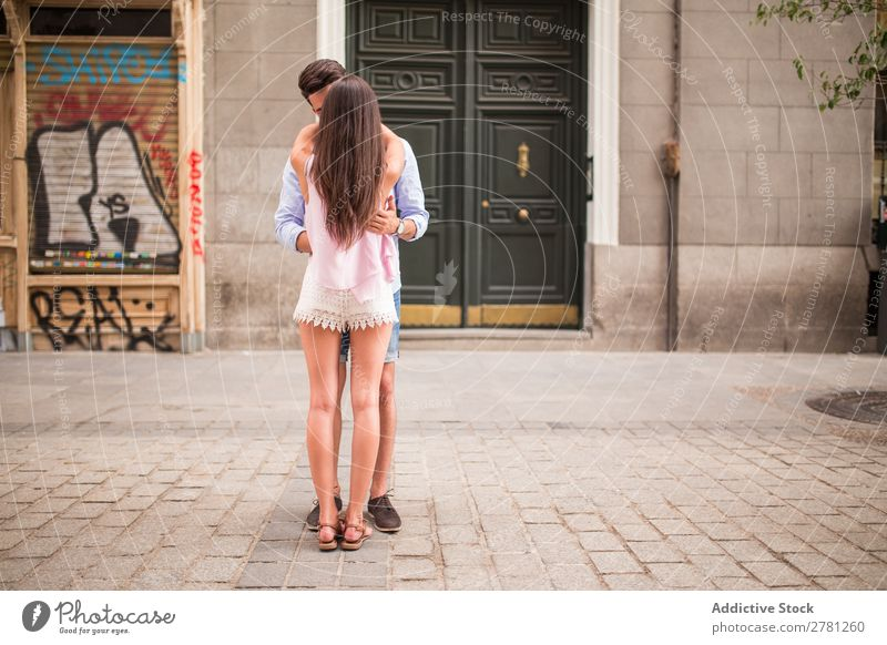Back view of couple hugging in the street Couple Embrace Rear view Street City Unrecognizable Brunette Thin