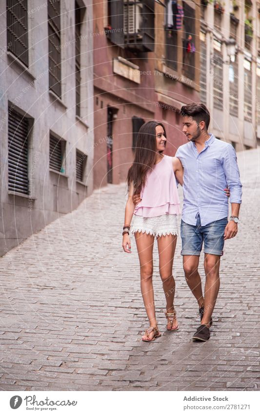 Happy couple walking on street Couple Embrace Walking Woman Face to face Style Man