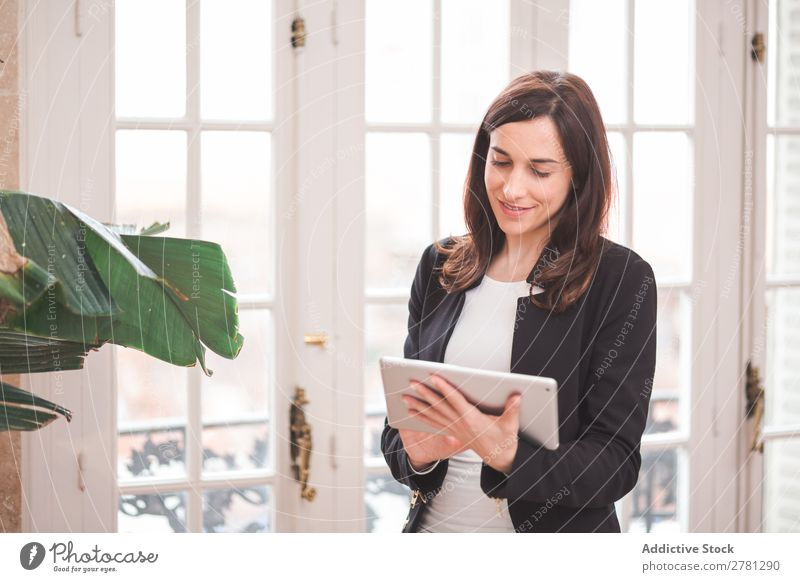 Young smiling woman standing with tablet Woman Tablet computer Smiling Technology Posture Cheerful Stand Gadget Modern Digital Businesswoman Entrepreneur