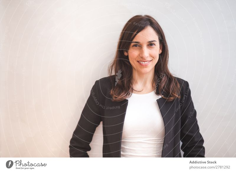 Young smiling woman in suit posing Businesswoman Posture Smiling Gesture Portrait photograph Cheerful Stand Successful Self-confident Positive crossed arms
