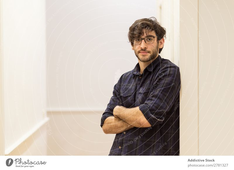 Young man with glasses in shirt posing Man Posture Portrait photograph Gesture Stand Friendliness crossed arms Positive Smiling Looking into the camera