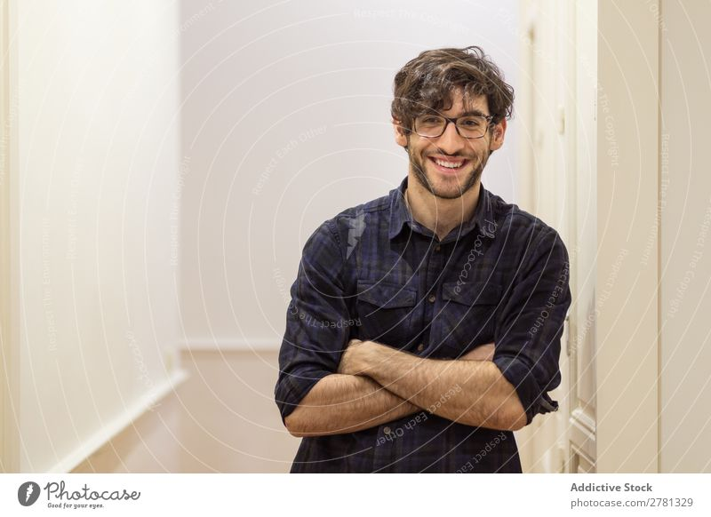 Young smiling male in shirt posing Man Posture Smiling Cheerful Portrait photograph Gesture Stand Friendliness crossed arms Positive Looking into the camera