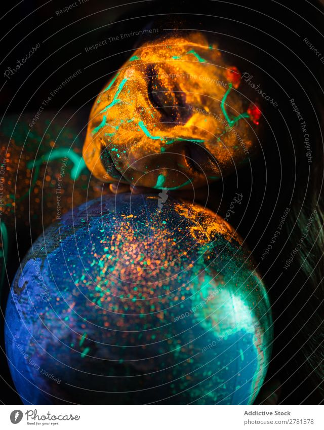 Woman with luminous paint and globe Youth (Young adults) pretty Colour Globe Model Map eyes closed Painting (action, artwork) Fluorescent Illuminate Art Neon