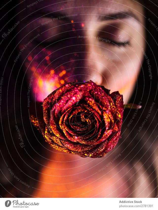 Young woman with glittering rose in mouth Woman Youth (Young adults) pretty eyes closed Rose Red Glittering Mouth Colour Painting (action, artwork) Fluorescent