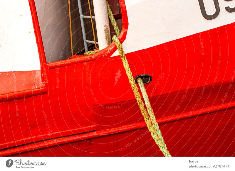 Mooring line to a red-white fishing boat Design Navigation Fishing boat Maritime Red mooring lines fishing cutter White Harbour moored hemp ropes Picturesque