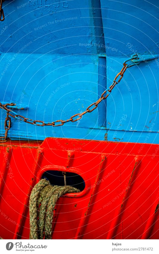 Mooring line to a red-blue fishing boat Design Navigation Fishing boat Maritime mooring lines fishing cutter Blue Red colourful Harbour anchored lashed Chain