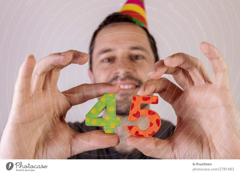 Man holding two numbers in his hand, anniversary celebration Party Event Feasts & Celebrations Carnival Birthday Adults Face Hand Fingers 1 Human being Hat