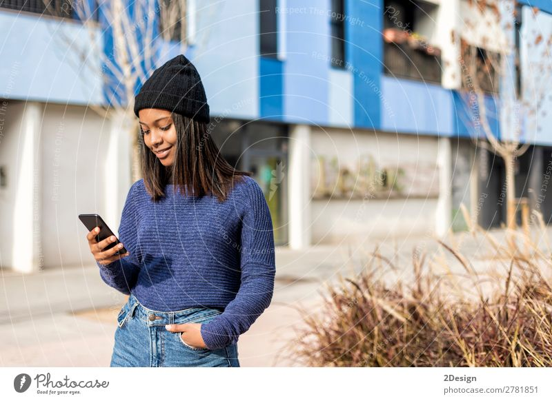 Happy woman with hat in city street, while using technology Style Beautiful Hair and hairstyles PDA Technology Human being Feminine Young woman