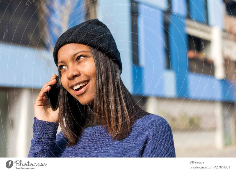 Portrait of a cheerful young african woman standing outdoors Style Joy Beautiful To talk Telephone PDA Technology Human being Feminine Young woman