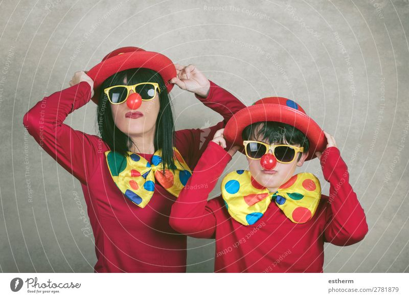 mother with son with clown nose and hat Lifestyle Joy Feasts & Celebrations Mother's Day Carnival Hallowe'en Birthday Human being Masculine Feminine Young woman