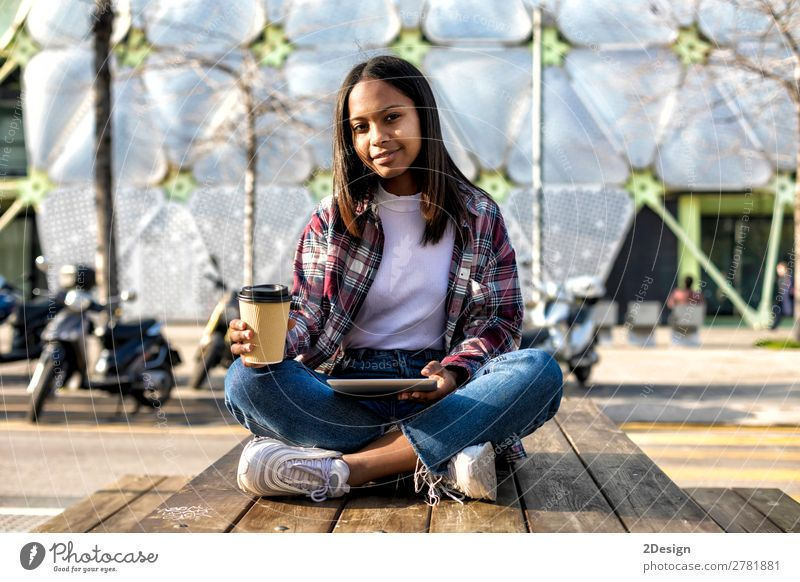 Young beautiful african american woman sitting outdoors Woman Human being Youth (Young adults) Young woman Beautiful 18 - 30 years Adults Feminine Laughter