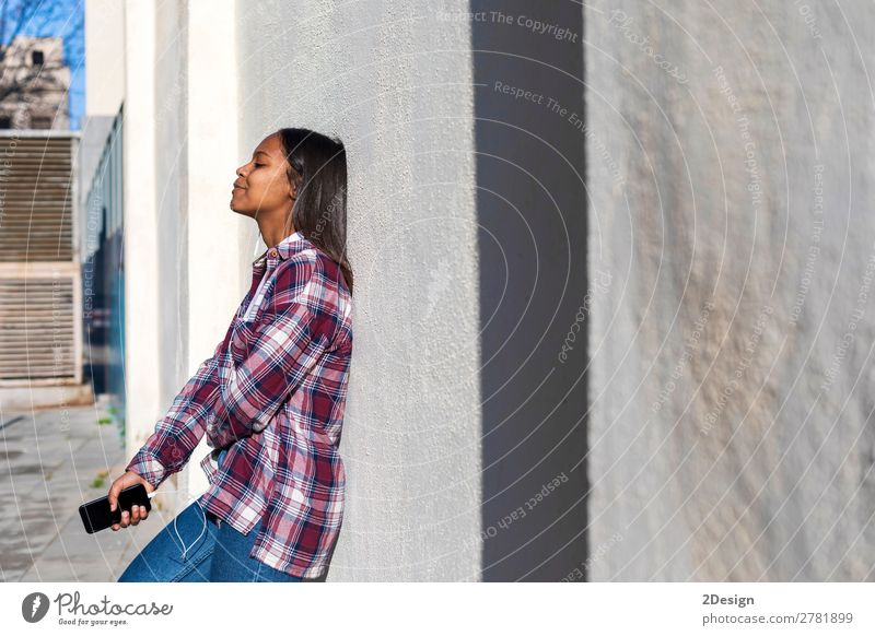 Beautiful young african american woman leaning on a white wall Woman Human being Youth (Young adults) Young woman White Black 18 - 30 years Lifestyle Adults
