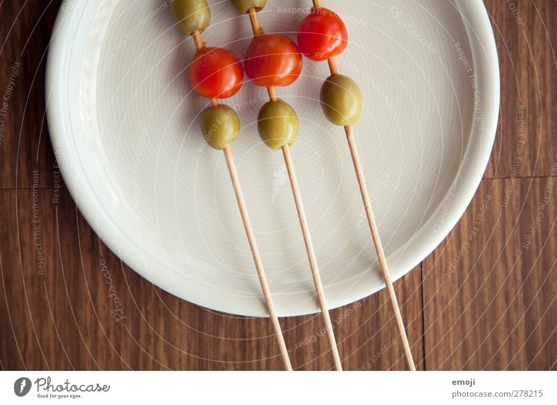green-red Food Vegetable Vegetarian diet Diet Italian Food Plate Healthy Green Red Appetizer Impaled Olive Tomato Colour photo Close-up Detail Deserted Day