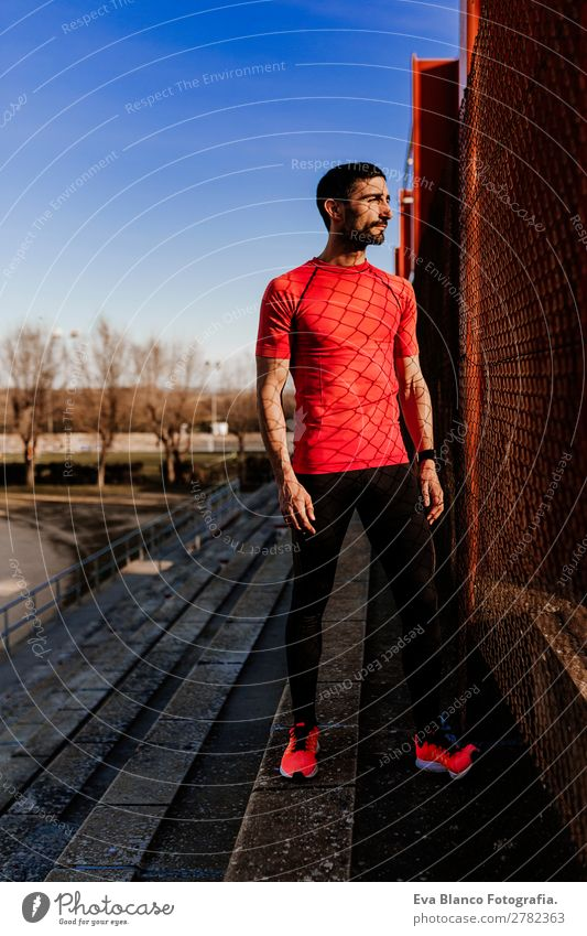 young male runner in the athletics stadium Lifestyle Leisure and hobbies Sports Track and Field Jogging Masculine Young man Youth (Young adults) Man Adults 1