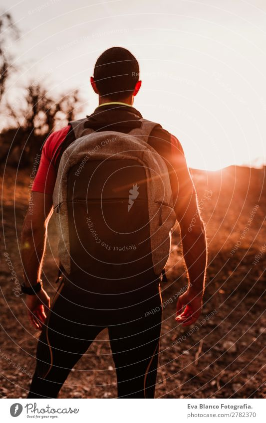 young hiker man at sunset Lifestyle Leisure and hobbies Sports Hiking Human being Masculine Young man Youth (Young adults) Man Adults 1 30 - 45 years Nature