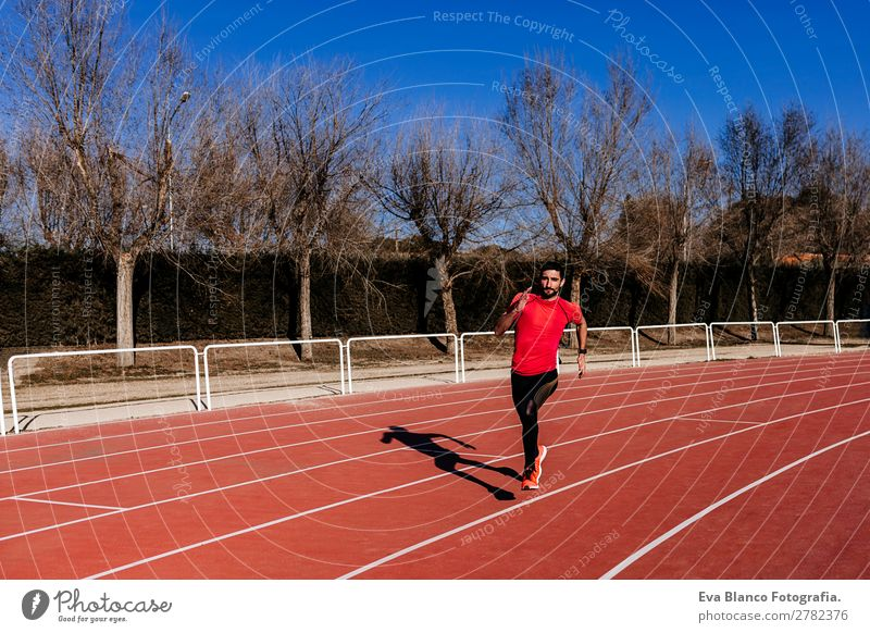 young athlete man running in the lanes. Daylight Lifestyle Leisure and hobbies Sports Jogging Human being Masculine Young man Youth (Young adults) Man Adults 1