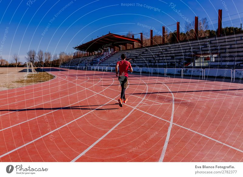 young athlete man running in the lanes. Daylight Lifestyle Leisure and hobbies Sports Jogging Masculine Young man Youth (Young adults) Man Adults 1 Human being