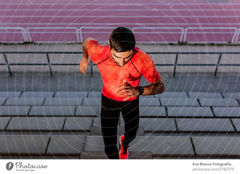 young athlete man running in the steps. Sports Lifestyle Leisure and hobbies Track and Field Masculine Young man Youth (Young adults) Man Adults 1 Human being