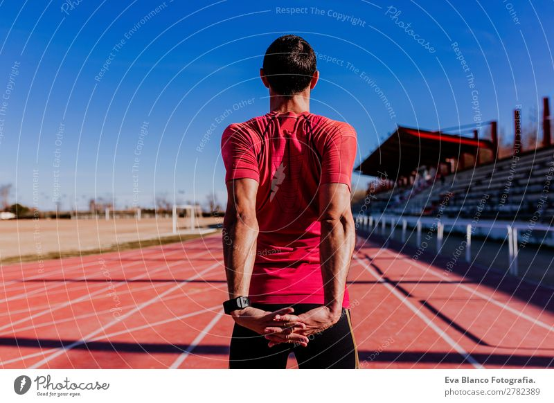 young runner man athlete at the race track. Sports outdoors Lifestyle Leisure and hobbies Track and Field Jogging Masculine Young man Youth (Young adults) Man