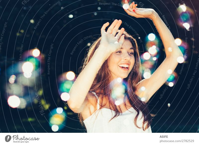 Girl dancing with bubbles Joy Happy Beautiful Playing Summer Feasts & Celebrations Human being Woman Adults Nature Warmth Park Dream Happiness Soft Green Soap