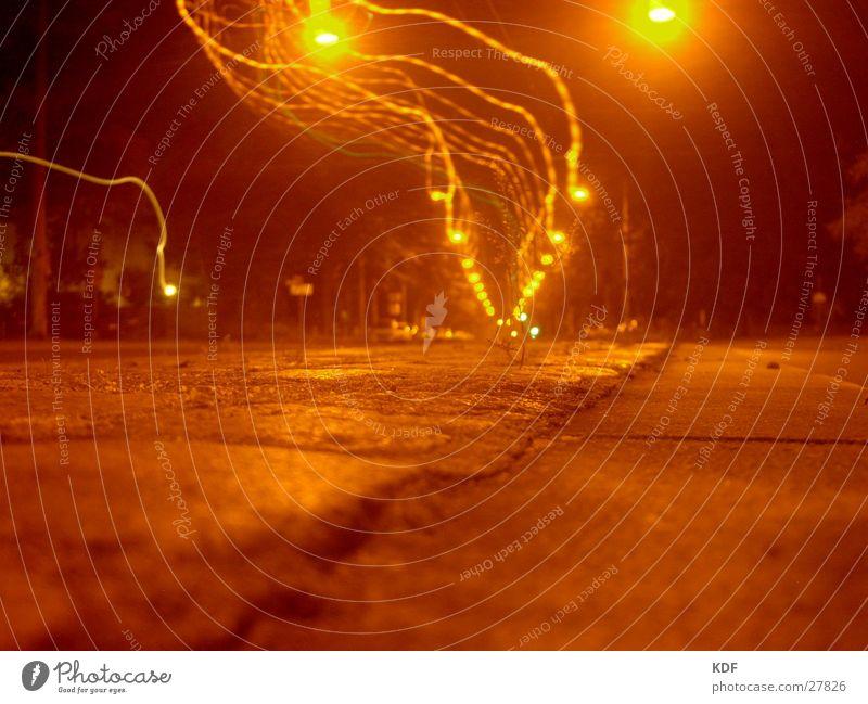 Tree Loneliness Street Dark Warmth Orange Physics Railroad tracks Lightning Lantern Sidewalk Cobblestones Plantlet