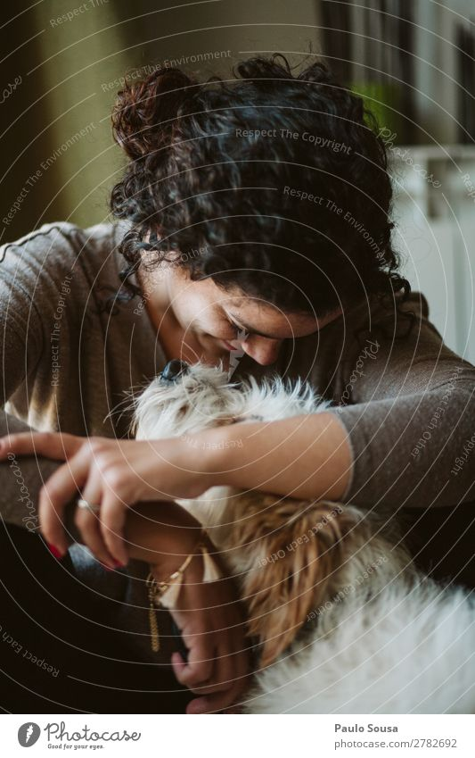 Girl and dog Human being Feminine Young woman Youth (Young adults) 1 18 - 30 years Adults Curl Pet Dog Animal To enjoy Smiling Love Sit Authentic Friendliness