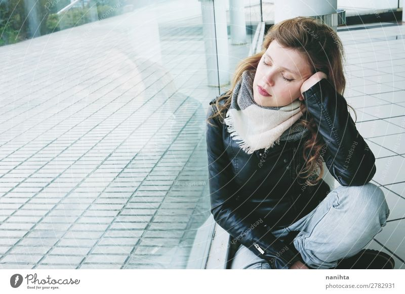 Young beautiful woman reflected in a huge window Woman Human being Youth (Young adults) Young woman Town Beautiful Relaxation Loneliness Calm Window
