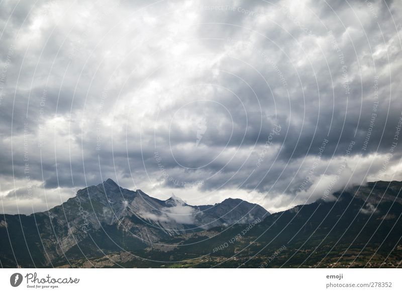 mountain Environment Nature Landscape Sky Clouds Storm clouds Climate Climate change Bad weather Wind Gale Thunder and lightning Alps Mountain Threat Gray