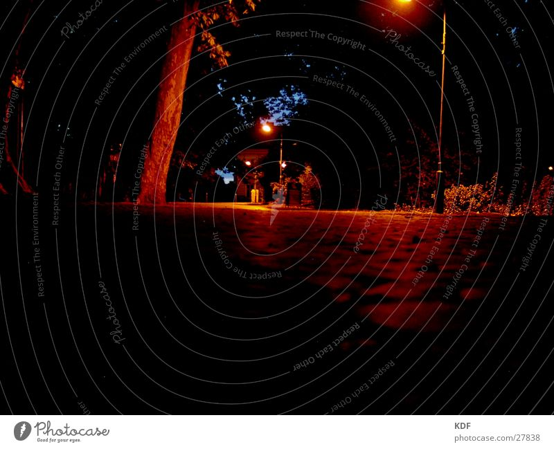 Dark streets Night Yellow Black Lantern Cobblestones Light Glittering Long exposure Street Berlin KDF Orange Shadow