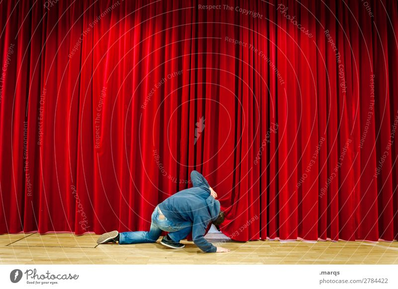 Man looks under a red curtain Human being Adults 1 Stage Cinema Drape Red Curiosity Search Shows Voyeurism Colour photo Interior shot Structures and shapes
