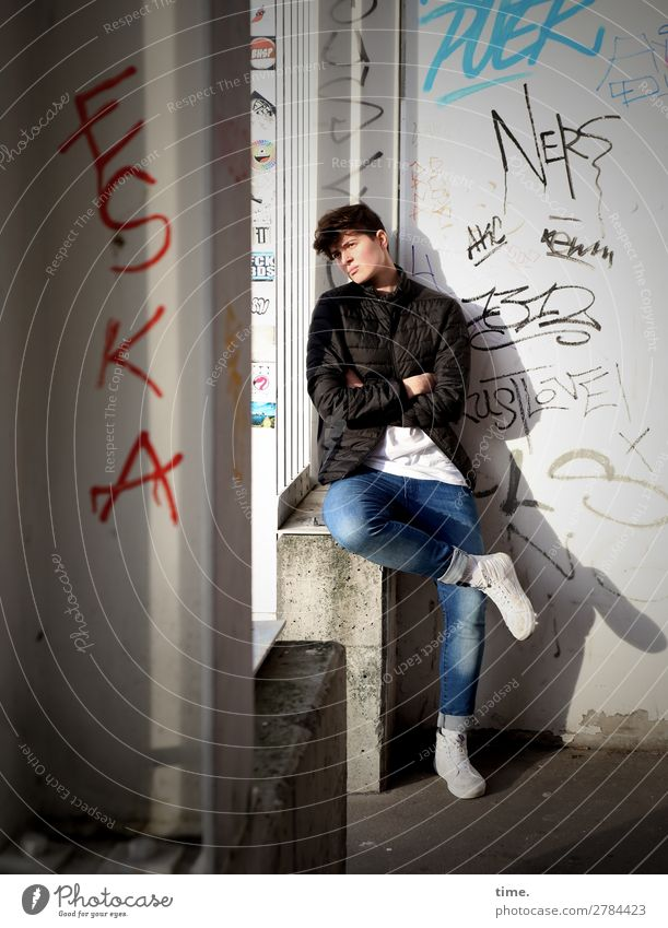 Stella Feminine Woman Adults 1 Human being Wall (barrier) Wall (building) Entrance T-shirt Jeans Jacket Sneakers Stone Concrete Graffiti Observe Think Sit Wait