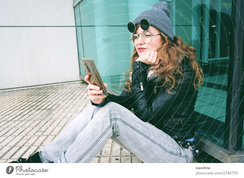 Young influencer woman using her smartphone Woman Human being Youth (Young adults) Young woman Town Beautiful White 18 - 30 years Lifestyle Adults Natural