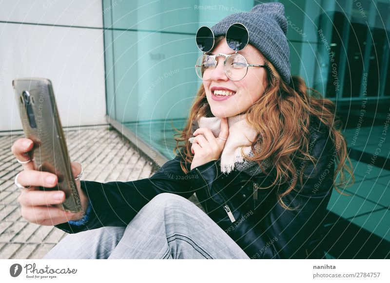 Young influencer woman using her smartphone Lifestyle Style Joy Beautiful Hair and hairstyles Leisure and hobbies Work and employment Business Telephone