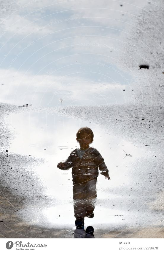 puddle frits Human being Child Toddler Infancy 1 1 - 3 years Water Walking Wet Puddle Colour photo Exterior shot Copy Space top Reflection
