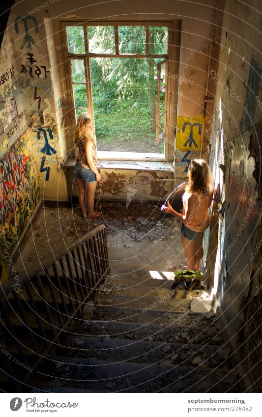 interior shot Feminine Youth (Young adults) 2 Human being 18 - 30 years Adults Wall (barrier) Wall (building) Stairs Old Cool (slang) Colour photo Interior shot
