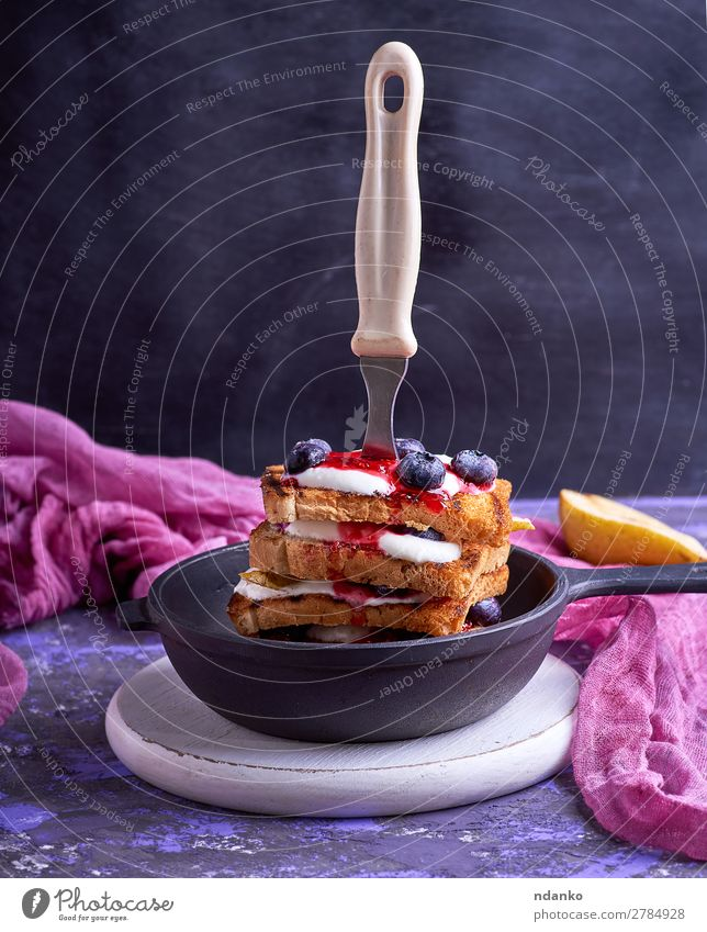 French toast with berries, syrup and sour cream Fruit Bread Nutrition Breakfast Lunch Pan Fork Table Kitchen Wood Eating Black White appetizing board eat food