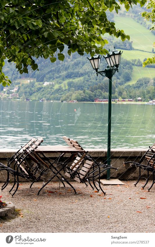 Lake Zell Water Alps Zell lake Austria Wall (barrier) Wall (building) Vacation & Travel Lamp post Garden chair Green Calm Lakeside Freshwater Mountain