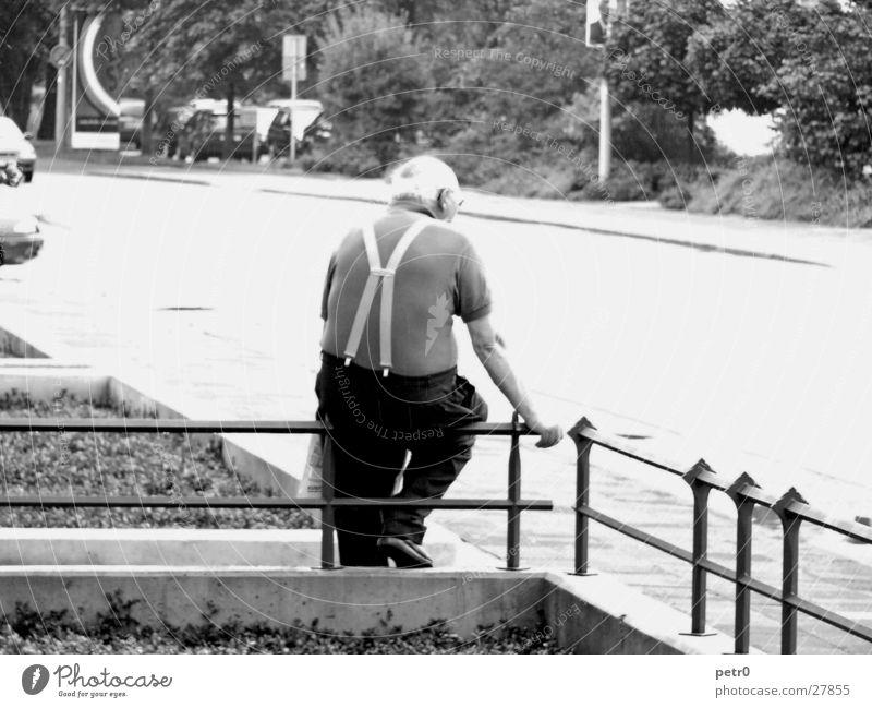Man Senior citizen Street Wait Sit Sidewalk Fence Brilliant Overexposure Glistening Suspenders Front garden Male senior