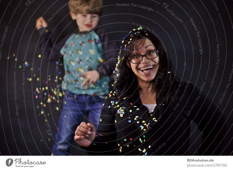 Confetti | Child throws woman with confetti Human being Boy (child) Woman Adults 2 3 - 8 years Infancy 30 - 45 years Eyeglasses Laughter Throw Authentic