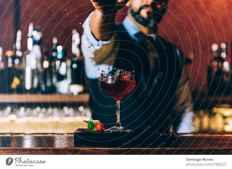 Barman is making cocktail at night club. Cocktail shaker barman bartender Waiter Man Stir mixologist adding Alcoholic drinks Business Club Splash Drop Drinking