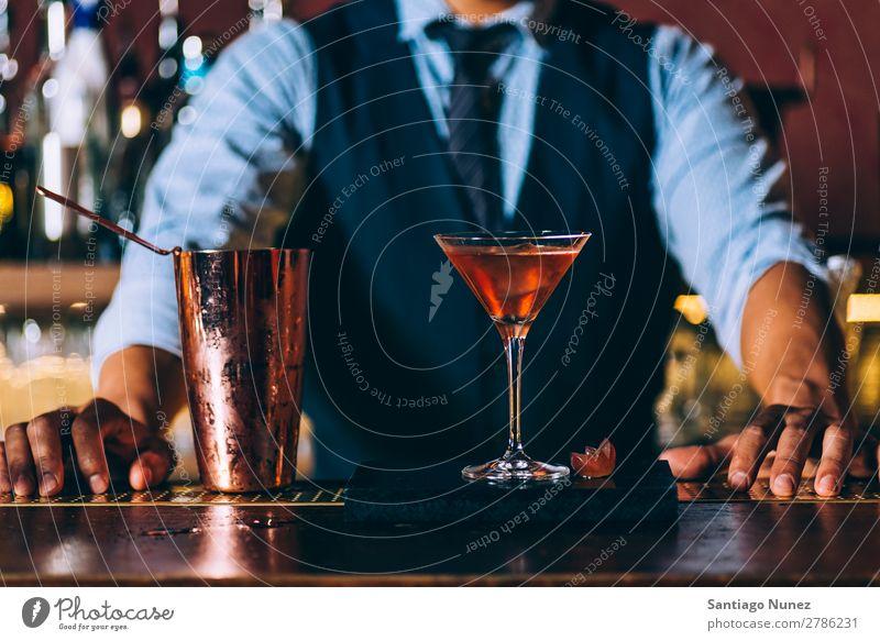 Barman is making cocktail at night club. Cocktail shaker barman bartender Waiter Man Stir mixologist adding Alcoholic drinks Business Club Drinking Bottle