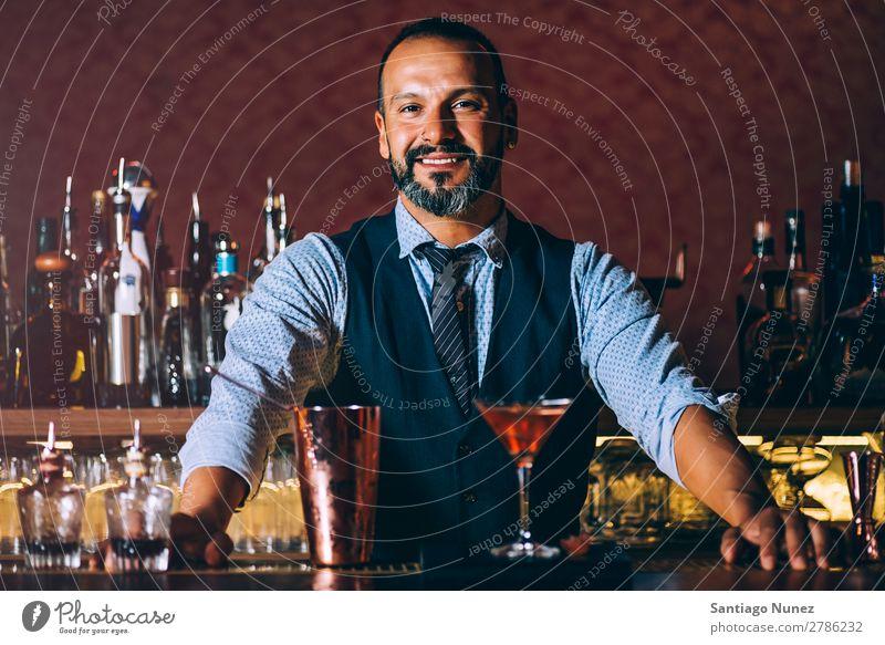 Barman is making cocktail at night club.Barman is making cocktail at night club. Cocktail shaker barman bartender Waiter Man Portrait photograph portraiture