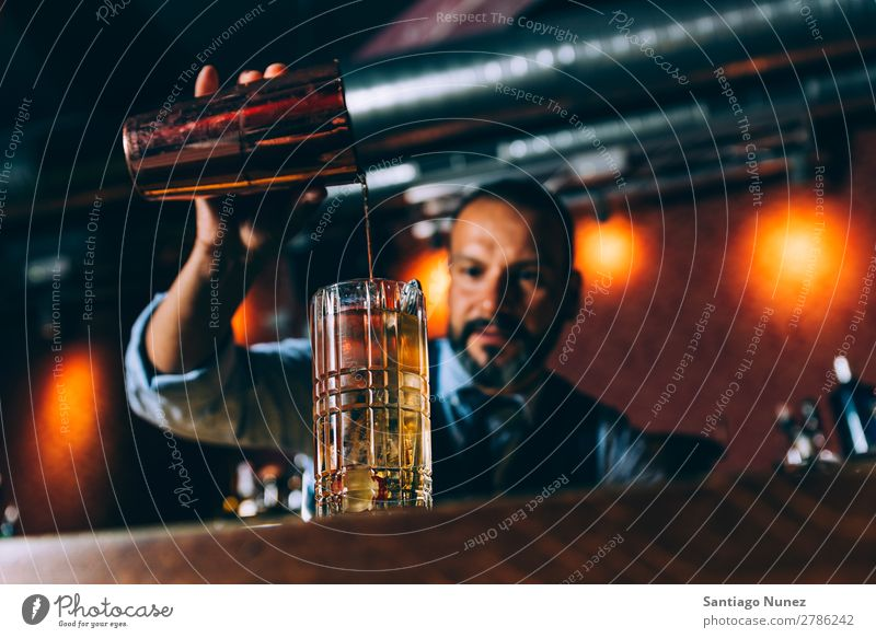 Barman is making cocktail at night club. Cocktail shaker barman bartender Waiter Man Stir mixologist adding Alcoholic drinks Business Club Drinking Bottle