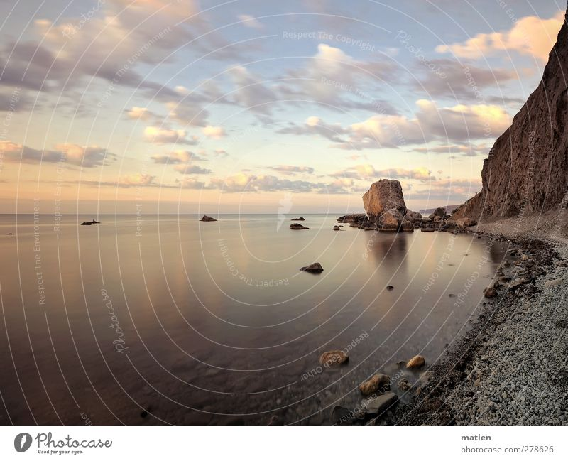 crashed Landscape Sky Clouds Summer Beautiful weather Coast Beach Bay Ocean Brown Calm Moody Stone Rock Fragment Colour photo Exterior shot Deserted Dawn Day