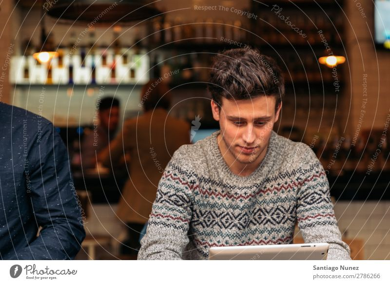 Businessman using his laptop in the Coffee Shop. Man Friendliness Portrait photograph Youth (Young adults) Human being Lifestyle Communication Computer Notebook